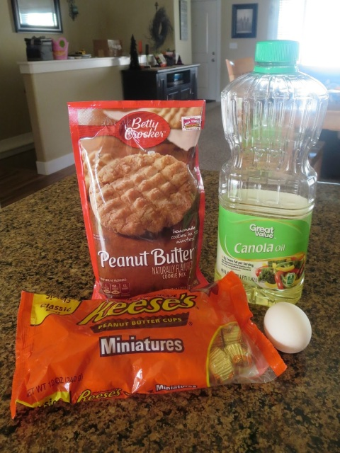 Quick and Easy Peanut Butter Cup Cookies--Just a cookie mix and a bag of Reese's miniatures and you've got yourself a great dessert!