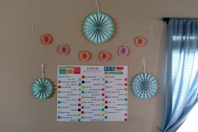 It's easy to make your summer bucket list a fun part of your decor with colorful paper fans.